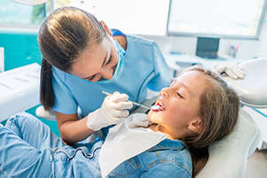 A child receiving treatment for gingivitis at Alder Dental in Vancouver, WA