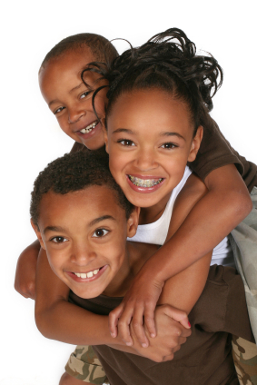 Three kids holding each other, Alder Dental in Vancouver WA
